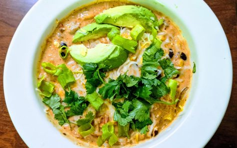 Toppings take this homemade enchilada soup to divinity status. Creamy avocado sprinkled with lime juice and salt, crisp tortilla strips, spicy sliced green onions and fragrant cilantro make this soup a fiesta in a bowl. (Photo by Laura Woolfrey Macklem)